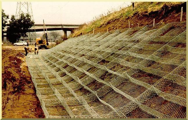 Placing gabions on dry banks