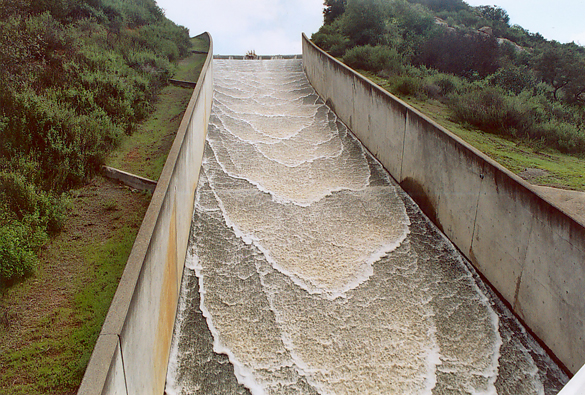 Roll waves on the spillway at Turner reservoir, San Diego County, California.