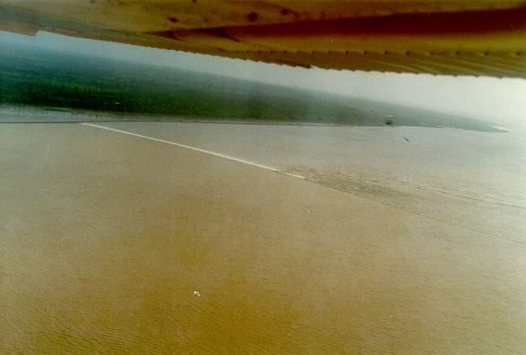 Tidal bore on the Araguari river, Amapa, Brazil, at 8:00 am, on January 22, 1989.