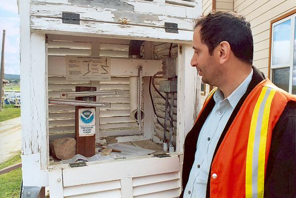 Hamzeh Ramadan inspecting temperature gage at Campo valley, San Diego County.