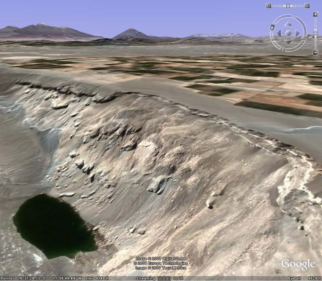 >Panoramic of La Cano slide zone, showing lagoon on bottom left and irrigated pampas on top right